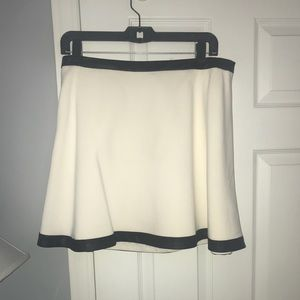 Ivory skirt with faux leather trim